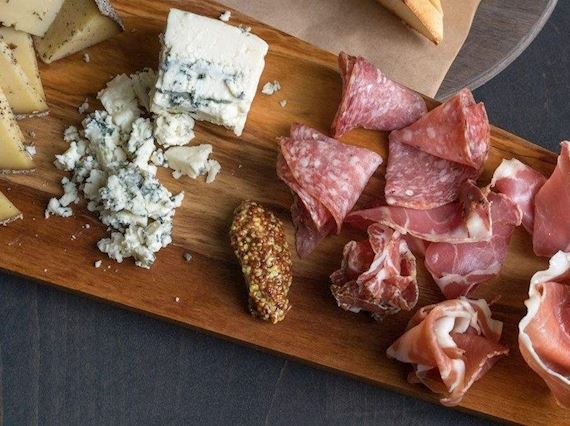 Charcuterie board with meats and cheese